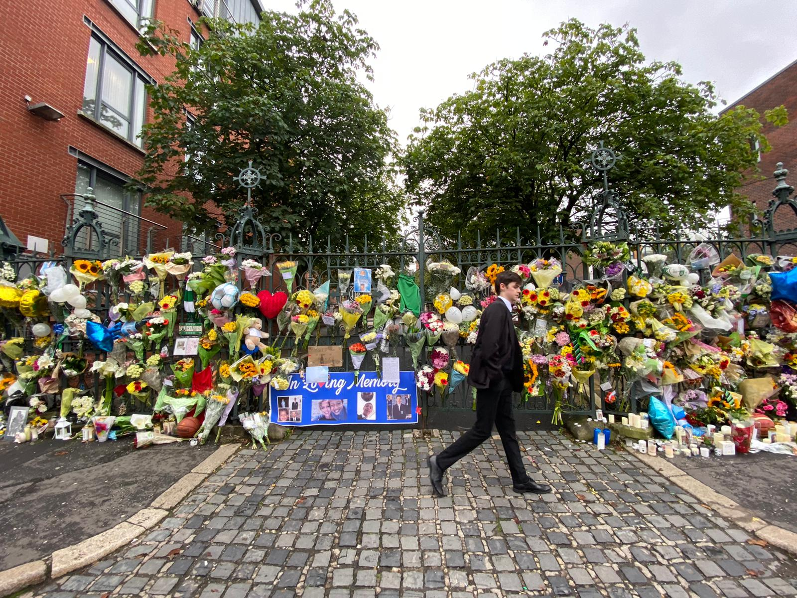 OUTPOURING: Floral tributes left at gates of St Malachy\'s College.